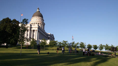 People lounge in the shadows of the Utah capitol building Footage