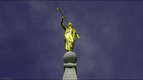 Golden statue atop Mormon temple Footage