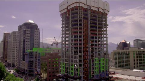Medium-long tilt up a skyscraper under construction Footage