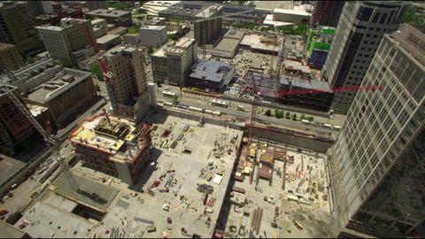 Pan of construction site from skyscraper Footage