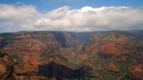 Time-lapse of clouds passing over the Wiamea Canyon in Kauai, Hawaii Footage