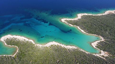 Aerial - White sand beach with clear blue water Live Action