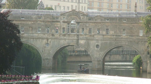 Small boat going under a bridge in England Footage