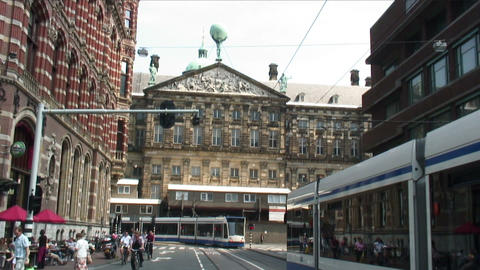 Trams passing the Palace of Amsterdam Live Action