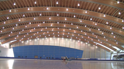 Wide pan of an Olympic ice rink in Vancouver Footage