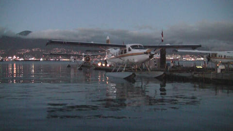 Plane in the bay at Vancouver with Olympic rings in the background Footage