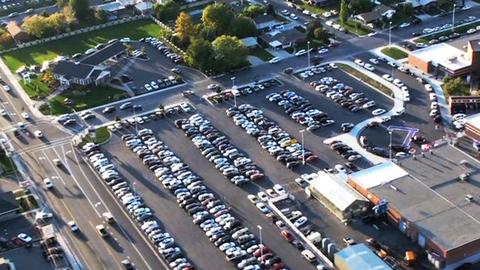 Aerial shot of high school and football field in Utah Footage