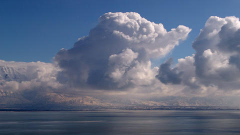 Timelapse shot of flufly cloud formations in Utah Footage