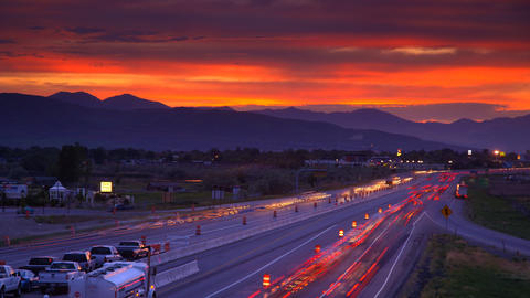 Time-lapse shot of cars travelling along the road at the Utah valley at sunset Footage