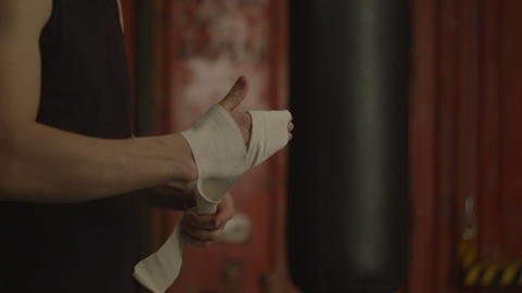 Boxer hands wrapping with white boxing wraps Footage