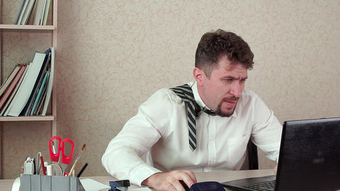 The office Manager of a bearded man, tired of work, swearing at the laptop Live Action