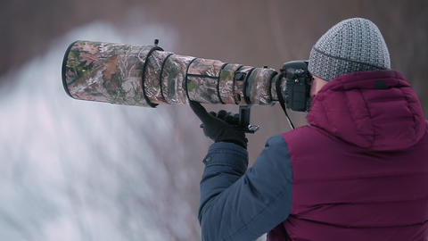 Man Taking Photo with Telephoto Lens in Winter Footage