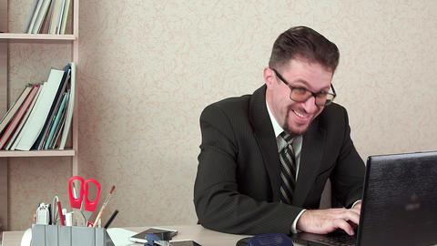 Funny office Manager, fun typing message in laptop. He's in the workplace Live Action