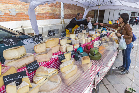 French cheese sales stand at the Sunday Market in Grenoble, France Photo