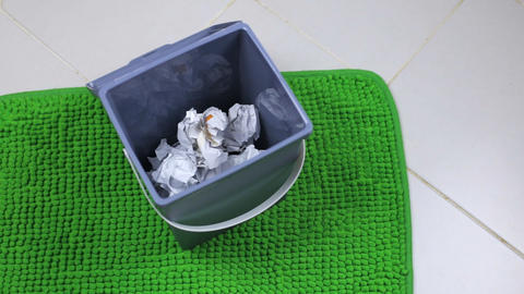 A bucket filled with crumpled paper Footage