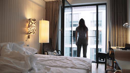 Young Woman Walking By Happily in Bedroom Footage
