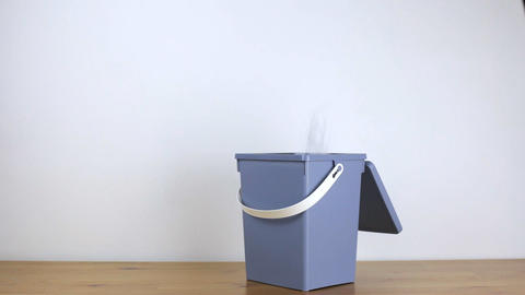 Paper flies into an office bin that quickly fills Footage