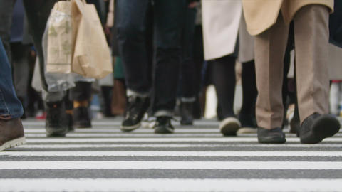 SlowMotion - Peoples walking on a crosswalk Tokyo Shinjuku FIX FrontView Cloudy GIF
