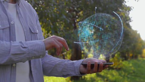 Unrecognizable man shows conceptual hologram with text Developer Live Action