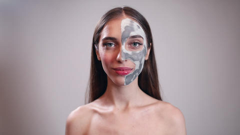 Smiling Young Girl with Clay Mask on Half Face Live Action