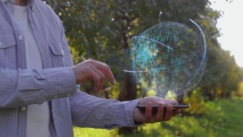 Unrecognizable man shows conceptual hologram with text E-commerce Live Action
