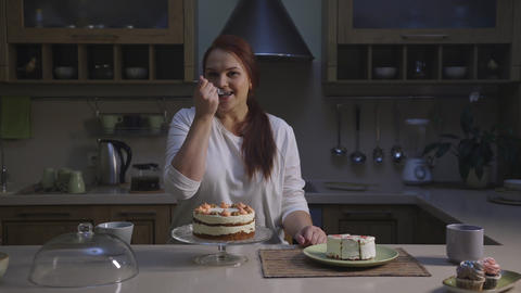 Female confectioner chef cook healthy organic cupcakes and tasting a slice GIF
