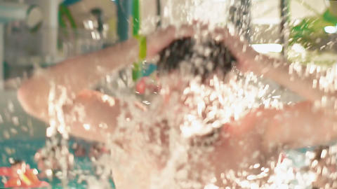 Bearded man resting in indoor aqua park. He splashes water Footage