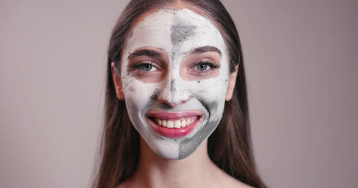 Smiling Young Girl with Clay Mask on Face Footage