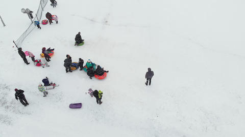 Happy people having fun on the snow in winter park. aerial survey, copter shoot ビデオ