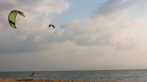 two kitesurfers train on Koh Phangan in Thailand Footage