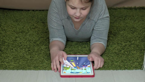 girl playing on the tablet in the room, web surfing, rest Footage