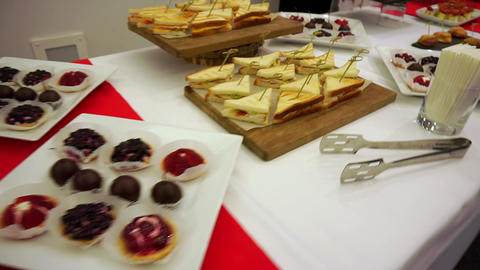 Concept catering. Snacks on the plates, stand on the table Live Action