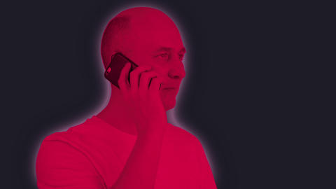 Adult man using mobile phone on dark background. Multicolor coloring video GIF