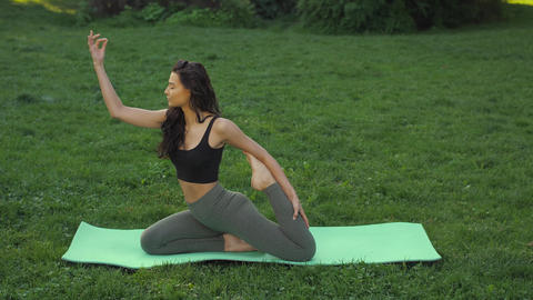 Healthy sports lifestyle. Woman practicing yoga outdoors... Stock Video Footage