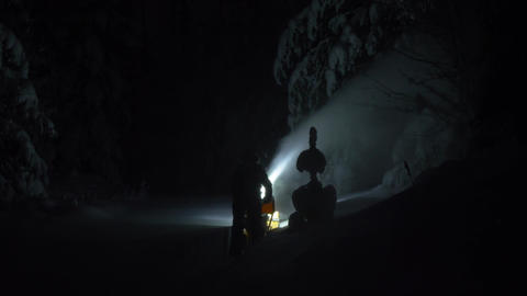 Snowblower working in deep snow in dark night Live Action
