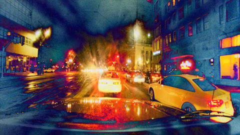 A crazed, extreme careening drive through a nightime city Footage