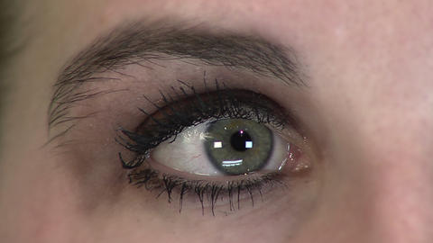 A closeup of a woman's eye looking back and forth Footage