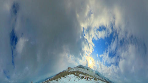 Time-lapse fisheye shot of the sun and sky over the mountain in Utah with lens f Footage