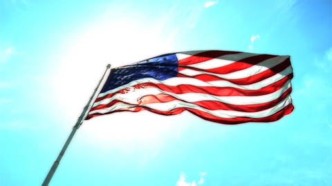 An American flag flies against an azure sky Footage