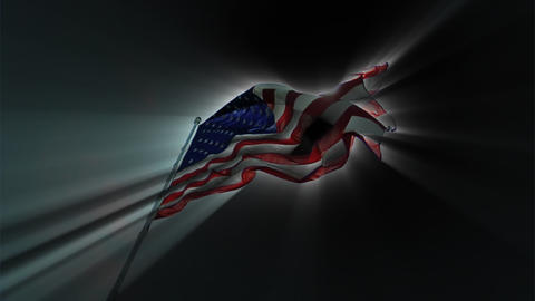 A dark American flag flies, radiating rays of light Footage