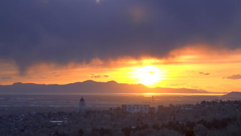 Time-lapse panning shot of sunset over Utah mountains with lens flare as seen fr Footage