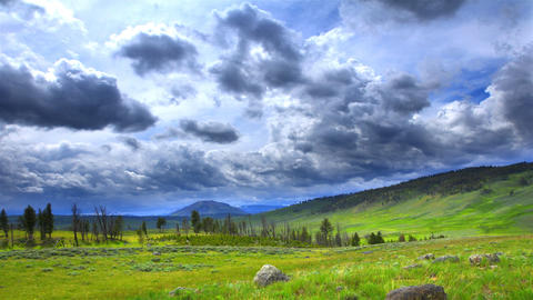 Time-lapse of mountains and meadow in Wyoming Footage
