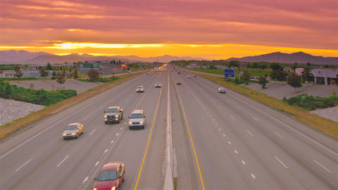 Time-lapse shot of traffic on a highway in Utah taken from an overpass Footage