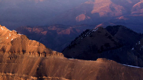 Aerial shot of red mountains with snow-covered peaks in Utah Footage
