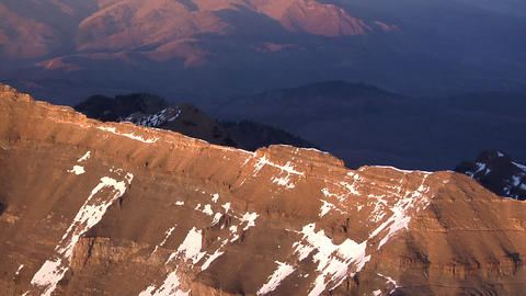 Aerial shot of snow-covered red mountains in Utah Footage