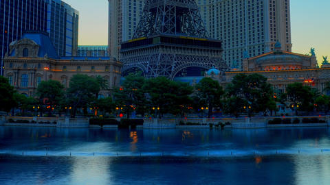 Static, timelapse of the Bellagio hotel's huge fountain pool with hotels beyond Live Action