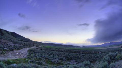 Time-lapse shot of an open field in Utah Footage
