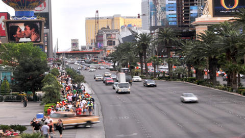 Zooming of the busy Las Vegas Strip packed with tourists maneuvering on the side Footage