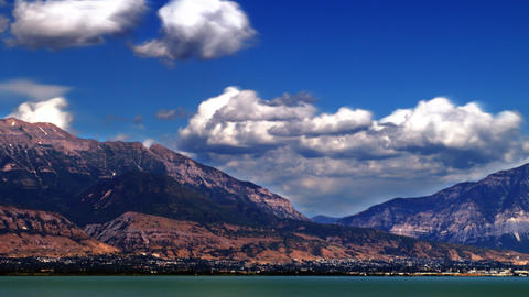 Time-lapse shot of mountains by the lake in Utah Footage