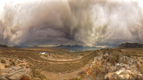 Wide time-lapse shot of the Utah valley while storm clouds come in Footage